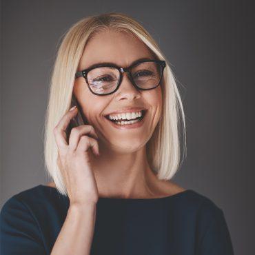 laughing-busineswoman-talking-on-her-cellphone-9K4LH7Z.jpg